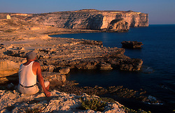MALTA GOZO DWEJRA JUL00 - A Maltese fisherman sits atop the window of Dwejra.. . . jre/Photo by Jiri Rezac. . © Jiri Rezac 2000. . Tel:   +44 (0) 7050 110 417. Email: info@jirirezac.com. Web:   www.jirirezac.com