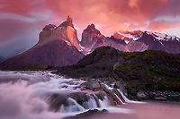 A red sunrise along the Paine River, Torres del Paine National Park, Chile