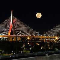 New England nature and astrology photography of a rising full moon over the iconic Boston Zakim Bridge. It is always a special treat and pleasure to experiencing and photographing a full moon.<br /> <br /> Super moon is the next step up and the next one is expected 14 November 2016. A supermoon is known as a new or full moon occurring at the same time the moon comes within 90 percent of its closest approach to Earth in a given orbit. It is an astronomical event that happens 4-6 times a year, but according to a NASA Science News story, last nights full moon nearly coincided with the moon's arrival at its closest point in its orbit around the Earth, resulting in the biggest, visible full moon in North America in two decades. Next super moon to watch November 14, 2016 ... mark your calendars.<br /> <br /> Boston full moon photos are available as museum quality photography prints, canvas prints, acrylic prints or metal prints. Fine art prints may be framed and matted to the individual liking and decorating needs:<br /> <br /> http://juergen-roth.pixels.com/featured/full-moon-rising-across-boston-zakim-bridge-juergen-roth.html<br /> <br /> All Boston skyline photos are available for digital and print image licensing at www.RothGalleries.com. Please contact me direct with any questions or request.<br /> <br /> Good light and happy photo making!<br /> <br /> My best,<br /> <br /> Juergen<br /> Prints: http://www.rothgalleries.com<br /> Photo Blog: http://whereintheworldisjuergen.blogspot.com<br /> Instagram: https://www.instagram.com/rothgalleries<br /> Twitter: https://twitter.com/naturefineart<br /> Facebook: https://www.facebook.com/naturefineart