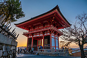 """Sunset twilight at Kiyomizu-dera (""""Pure Water Temple""""), an independent Buddhist temple in eastern Kyoto, Japan. Otowa-san Kiyomizu-dera temple is part of the Historic Monuments of Ancient Kyoto (Kyoto, Uji and Otsu Cities) UNESCO World Heritage site. Kiyomizu-dera was founded on the site of the Otowa Waterfall in the early Heian period, in 780 by Sakanoue no Tamuramaro. Ordered by Tokugawa Iemitsu, its present buildings were built entirely without nails in 1633."""