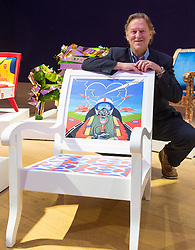 "Bonhams, London, February 29th 2016. Artist David Bent poses with his Red Arrows themed chair during a photocall for ""Sitting Pretty"", featuring unique, hand painted and upholstered chairs made by 30 celebrities and artists, at Bonhams ahead of their auction in support of a leading AIDS charity, CHIVA Africa.<br /> ©Paul Davey<br /> FOR LICENCING CONTACT: Paul Davey +44 (0) 7966 016 296 paul@pauldaveycreative.co.uk"