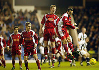 Photograph: Scott Heavey.<br /> West Bromwich Albion v Walsall. Nationwide Division One. 09/01/2004.<br /> Jason Koumas' free-kick deflects off of the Walsall wall for the opening goal