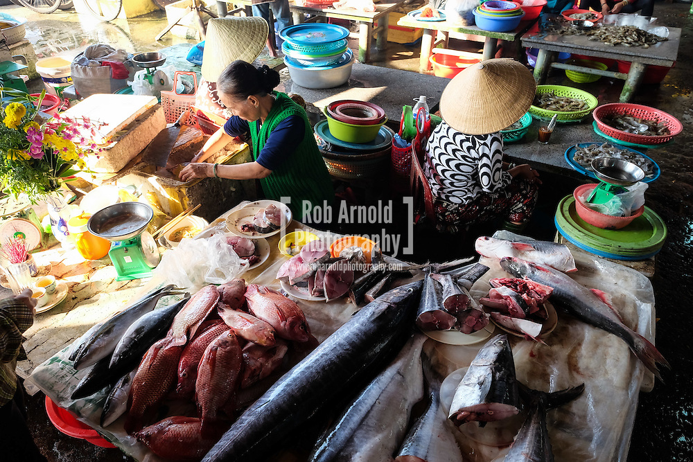 Ladies on their fish stalls in Hoi An Central Market