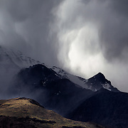 A spring storm drops snow and rain on the Steens Mountain range in south central Oregon, bordering the Alvord Desert