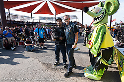 Custom bike builder Koh Sakaguchi of Suicide Customs in Aichi Prefecture in Japan gets his big award from Ted Smith at the Rats Hole annual custom bike show in the Crossroads area of the Buffalo Chip during the Sturgis Black Hills Motorcycle Rally. SD, USA. Thursday, August 8, 2019. Photography ©2019 Michael Lichter.