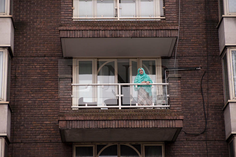 © Licensed to London News Pictures. 02/04/2015. Baker Street, London, UK. A Musilim woman looks on from a balcony overlooking London Central Mosque during the Islamic Rally.  Photo credit : Stephen Chung/LNP