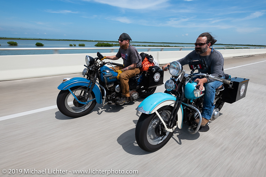 Kyle Rose (L) riding alongside Chris Salisbury on the last day of the Cross Country Chase motorcycle endurance run from Sault Sainte Marie, MI to Key West, FL. (for vintage bikes from 1930-1948). Stage-10 covered 110 miles from Miami to the finish in Key West, FL USA. Sunday, September 15, 2019. Photography ©2019 Michael Lichter.