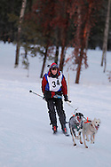 Photo Randy Vanderveen.Grande Prairie , Alberta.13-01-05.Lee Verge urges her dogs through the race course as she takes part in the skijor event ? dogs pull the musher around the course on skis as opposed to a sled. The Grande Prairie Sled Dog Derby ran two days of races at Evergreen Park this past weekend, Jan. 5 and 6.