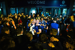© Licensed to London News Pictures. 09/05/2021. Bolton, UK. HARRY BROCKBANK kisses EOIN DOYLE as the team celebrates with fans outside the club's hotel . Bolton Wonderers supporters celebrate outside the University of Bolton stadium after BWFC won promotion to League One following the team's 1-4 victory over Crawley Town . Photo credit: Joel Goodman/LNP