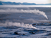 The Pole of Cold - Tomtor village seen from a nearby mountain. The area is extremely cold during the winter. Two towns by the highway, Tomtor and Oymyakon, both claim the coldest inhabited place on earth (often referred to as -71.2°C, but might be -67.7°C) outside of Antarctica. The average temperature in Oymyakon in January is -42°C (daily maximum) and -50°C (daily minimum). The images had been made during an outside temperature in between -50°C up to -55°C. Tomtor, Jakutien, Yakutia, Russian Federation, Russia, RUS, 19.01.2010