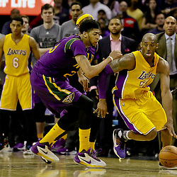 Feb 4, 2016; New Orleans, LA, USA; New Orleans Pelicans forward Anthony Davis (23) defends Los Angeles Lakers forward Kobe Bryant (24) during the fourth quarter of a game at the Smoothie King Center. The Lakers defeated the Pelicans 99-96. Mandatory Credit: Derick E. Hingle-USA TODAY Sports