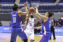 September 17, 2018 - Quezon City, NCR, Philippines - Khaled Mohamed Abdelbaset (White) of Qatar gets double teamed by Ian Sanggalang (10, Blue) and Alex Cabagnot (4, Blue) of the Philippines. (Credit Image: © Dennis Jerome S. Acosta/Pacific Press via ZUMA Wire)