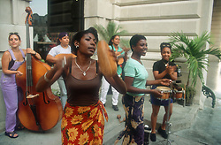 Group of women playing musical instruments outside restaurant in Havana; Cuba,
