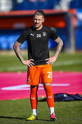 Luton Town midfielder George Moncur warms up ahead of the EFL Sky Bet League 1 match between Luton Town and Coventry City at Kenilworth Road, Luton, England on 24 February 2019.