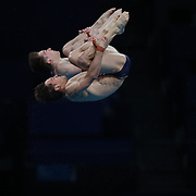 TOKYO, JAPAN - JULY 26: Tom Daley and Matty Lee of Great Britain during their gold medal performance in the Synchronised 10m Platform Diving for Men  at the Tokyo Aquatic Centre at the Tokyo 2020 Summer Olympic Games on July 26, 2021 in Tokyo, Japan. (Photo by Tim Clayton/Corbis via Getty Images)