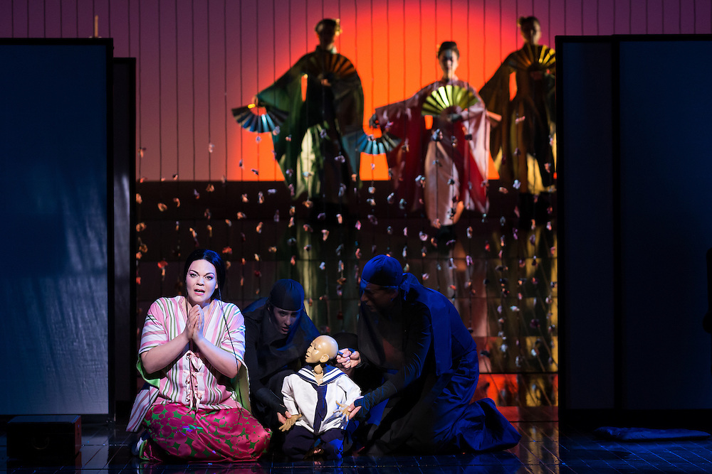 """LONDON, UK, 14 May, 2016. Rina Harms (front left, as Butterfly) rehearses with members of the cast for the revival of director Anthony Minghella's production of Puccini's opera """"Madam Butterfly"""" at the London Coliseum for the English National Opera. The production opens on 16 May. Photo credit: Scott Rylander."""