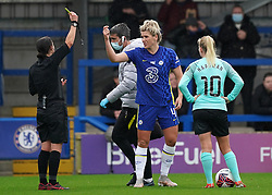Chelsea's Millie Bright receives a yellow card during the FA Women's Super League match at Kingsmeadow, London. Picture date: Saturday October 2, 2021.