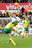 Norwich's Gary O'Neil clears as Swansea's Gylfi Sigurdsson tries to block it. Barclays Premier league match, Swansea City v Norwich city at the Liberty Stadium in Swansea, South Wales on Saturday 5th March 2016.<br /> pic by  Carl Robertson, Andrew Orchard sports photography.