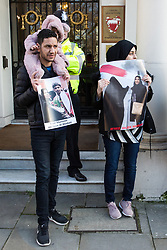 London, UK. 14th February, 2019. Sayed Ahmed Alwadaei (l) stands outside the Bahrain Embassy with activists from the Bahrain Institute for Rights and Democracy (BIRD) and Campaign Against the Arms Trade (CAAT) to mark eight years since the Day of Rage in Bahrain, a movement for democracy and social justice which was crushed by the Bahrain government with support from the military of Saudi Arabia. Speakers called for the release of political prisoners held in Bahrain and for the UK to stop licensing arms to Bahrain (over £100 million in licences have been granted since the uprising began in February 2011). Alwadaei was granted asylum in the UK in 2012 after being given a six-month sentence by the Bahrain government for his involvement in Arab Spring protests. Bahrain was recently found guilty by a UN body of arbitrarily detaining three of his relatives after he protested in London against a 2017 visit by the King of Bahrain Hamad bin Isa Al Khalifa.