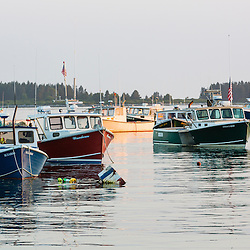 Lobster boats in the harbor as seen from the wharf at the Spuce Head Fisherman's Co-op in South Thomaston, Maine.
