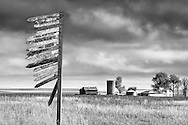 An old sign outside Hartline points the way to various family farms.