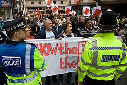 © Licensed to London News Pictures. 29/10/2011. Birmingham, UK. FILE PICTURE DATED 05/09/2009. Police hold back those opposed to an English Defence League demonstration in September 2009. Photo credit : Joel Goodman/LNP