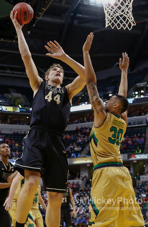 INDIANAPOLIS, IN - DECEMBER  20: Isaac Haas #44 of the Purdue Boilermakers shoots the ball against Zach Auguste #30 of the Notre Dame Fighting Irish at Bankers Life Fieldhouse on December 20, 2014 in Indianapolis, Indiana. Notre Dame defeated Purdue 94-63. (Photo by Michael Hickey/Getty Images) *** Local Caption *** Isaac Haas; Zach Auguste