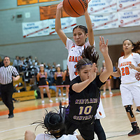 On Tuesday night, Cearra Williams (10) of Gallup draws the offensive foul on Monique Shim (10) of Kirtland Central in Gallup. Kirtland Central won 62-53.