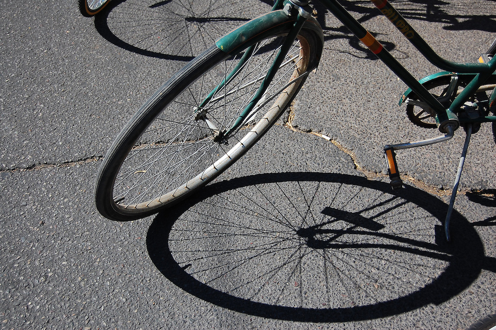 Bicycle front wheels and shadows. Bike-tography by Martha Retallick.