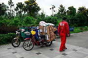 "Courriers sort and load shopping orders at one of the Yihaodian neighborhood distribution centers in Shanghai, China on 23 August, 2011. As online supermarkets is attracting a rapidly increasing number of young consumers, especially women, U.S. giant Walmart has acquired a minority stake in Yihaodian, or ""The Store"", a young but very successful E-Commerce company that sells and delivers everything from food, daily household  items, electronics, and clothing."