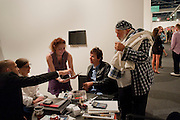 MAX WIGRAM; NAN BUSH; BRUCE WEBER, Vernissage. Opening of Art Basel Miami Beach. Convention Centre.  Miami Beach. 30 November 2010. -DO NOT ARCHIVE-© Copyright Photograph by Dafydd Jones. 248 Clapham Rd. London SW9 0PZ. Tel 0207 820 0771. www.dafjones.com.