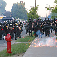 Minnesota State Patrol officers launch an offensive against protesters that gathered near the Minneapolis Police fifth precinct after a white police officer was caught on a bystander's video pressing his knee into the neck of African-American man George Floyd, who later died at a hospital, in Minneapolis, Minnesota, U.S. May 30, 2020. REUTERS/Adam Bettcher
