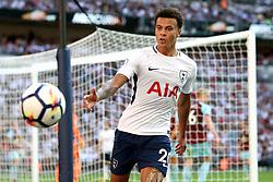 27 August 2017 - Premier League Football - Tottenham Hotspur v Burnley - Dele Alli of Tottenham reaches out for the ball - Photo: Charlotte Wilson