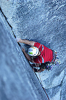 Young man climbing in Squamish, BC, Canada.<br />