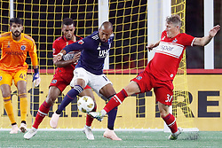 September 22, 2018 - Foxborough, MA, U.S. - FOXBOROUGH, MA - SEPTEMBER 22: New England Revolution midfielder Teal Bunbury (10) tries to play the ball between Chicago Fire defender Johan Kappelhof (4) and Chicago Fire midfielder Bastian Schweinsteiger (31) during a match between the New England Revolution and the Chicago Fire on September 22, 2018, at Gillette Stadium in Foxborough, Massachusetts. The teams played to a 2-2 draw. (Photo by Fred Kfoury III/Icon Sportswire) (Credit Image: © Fred Kfoury Iii/Icon SMI via ZUMA Press)