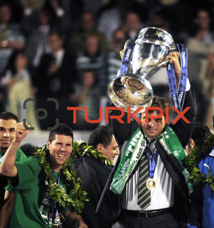 Turkish soccer league champions are Bursaspor. Bursaspor head coach Ertugrul SAGLAM celebrates with the lift the Super League trophy at Ataturk Stadium in Bursa Turkey on Monday, 17 May 2010. Photo by TURKPIX