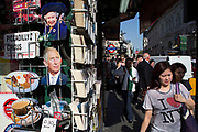 Tourist postcards of Prince Charles for sale near Piccadilly Circus, London, UK. Also other British icons such as the full English breakfast, the cup of tea and the Queen.