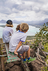 Three children looking at the Indian Ocean from a viewpoint, Mauritius
