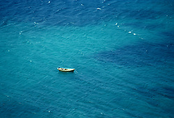 One rowboat in the Aegean Sea in Greece