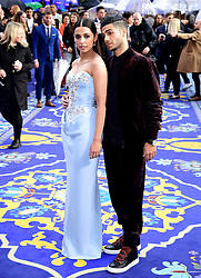 Naomi Scott and Mena Massoud attending the Aladdin European Premiere held at the Odeon Luxe Leicester Square, London.