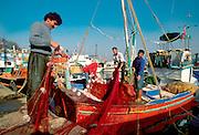 TURKEY, ISTANBUL, BOSPHORUS fishermen prepare nets before leaving the small fishing village of Rumelikavagi on the European shore