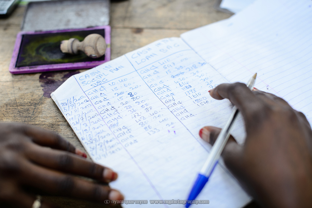 Members' contributions are recorded in a ledger at a 'Banking on Change' Village Savings and Loan Association (VSLA) meeting at Dabala Junction in the Volta Region of Ghana on 12 September 2012. Members contribute savings weekly and receive a payout commensurate with their inputs at the end of each year. Members may also access small loans, which many use to support entrepreneurial activities, and they make small insurance contributions which may be drawn upon in the event that an individual member has a financial emergency.