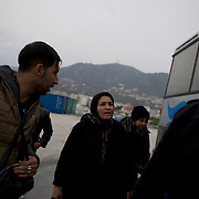 Rescued migrants are escorted to an UNHCR bus at Mytilene port in Lesbos island, Greece.