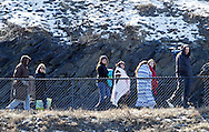 Chester, New York  - Spectators bundled up for the cold walk back to their cars after watching Mount Saint Mary College play SUNY Brockport in a baseball game at The Rock Sports Park on Feb. 26, 2012.