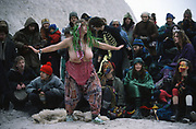 Mary dances the dragon. Donga theatre play in the Cutting. Road Protest actions at Twyford Down, near the Donga pathways, outside Winchester, against the M3 road extension. 1993<br /><br />The British Road Protesters movement began in the early 1990s when the Donga tribe squatted Twyford Down to save this beautiful site, a site of scientific interest SSI from the Ministry of transport's road building programme which threatened to destroy the landscape. The Dongas was the name of the ancient walkways, the paths trodden in the middle ages by people walking down to Winchester. A small tribe were joined by people of all walks of life who came to Twyford Down to defend it. A long hard battle over several years ended in the 'cutting' a new motorway built through this ancient monument and destroying it. <br /><br />The Road Protest movement in Britain continued for many years and more battles were fought in London against the MII both at Wanstead then in Leytonstone, and subsequently at Newbury, and in Sussex. the protesters were very inventive in their use of non violent peaceful direct action. They barricaded themselves into squats, made tree houses, tunnels and have huge demonstrations against the bailliffs, police and security who tried to force their way through the defences of this alternative environmental popular movement. Many of the roads were built eventually and many sites of great beauty lost, but the government had to stand down from its road building policy and eventually the programme was halted. the protests cost the government billions. Out of that movement grew many environmental NGOs who have to this day kept fighting for ecological and sustainable environmental solutions rather than following the cult of the car, petrol and roadbuilding..
