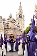 A procession leaves Seville Cathedral to walk back to its parish. Andalusia, Spain
