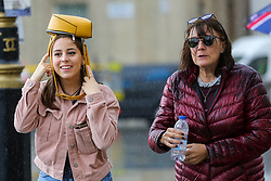 © Licensed to London News Pictures. 27/09/2019. London, UK. A woman covers her head with a purse during heavy downpour in London. According to the Met Office, this weekend is set to be washout with over 2o hours of rainfall in the capital. Photo credit: Dinendra Haria/LNP. Photo credit: Dinendra Haria/LNP