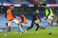 Manchester City players warm up during the Premier League match between Manchester City and Burnley at the Etihad Stadium, Manchester, England on 28 November 2020.