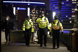 © Licensed to London News Pictures. 31/12/2020. London, UK. Police patrol Westminster Bridge  ahead of midnight and a muted New Year's Eve in central London. Photo credit: Peter Macdiarmid/LNP