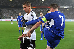 07.09.2012, AWD Arena, Hannover, GER, FIFA WM Qualifikation, Deutschland vs Faeroeer, im Bild Frooi Benjaminsen vor Lukas Podolski am Ball // during the FIFA World Cup Qualifier Match between Germany and Faroe Islands at the AWD Arena, Hannover, Germany on 2012/09/07. EXPA Pictures © 2012, PhotoCredit: EXPA/ Eibner/ Schwartz ***** ATTENTION - OUT OF GER *****